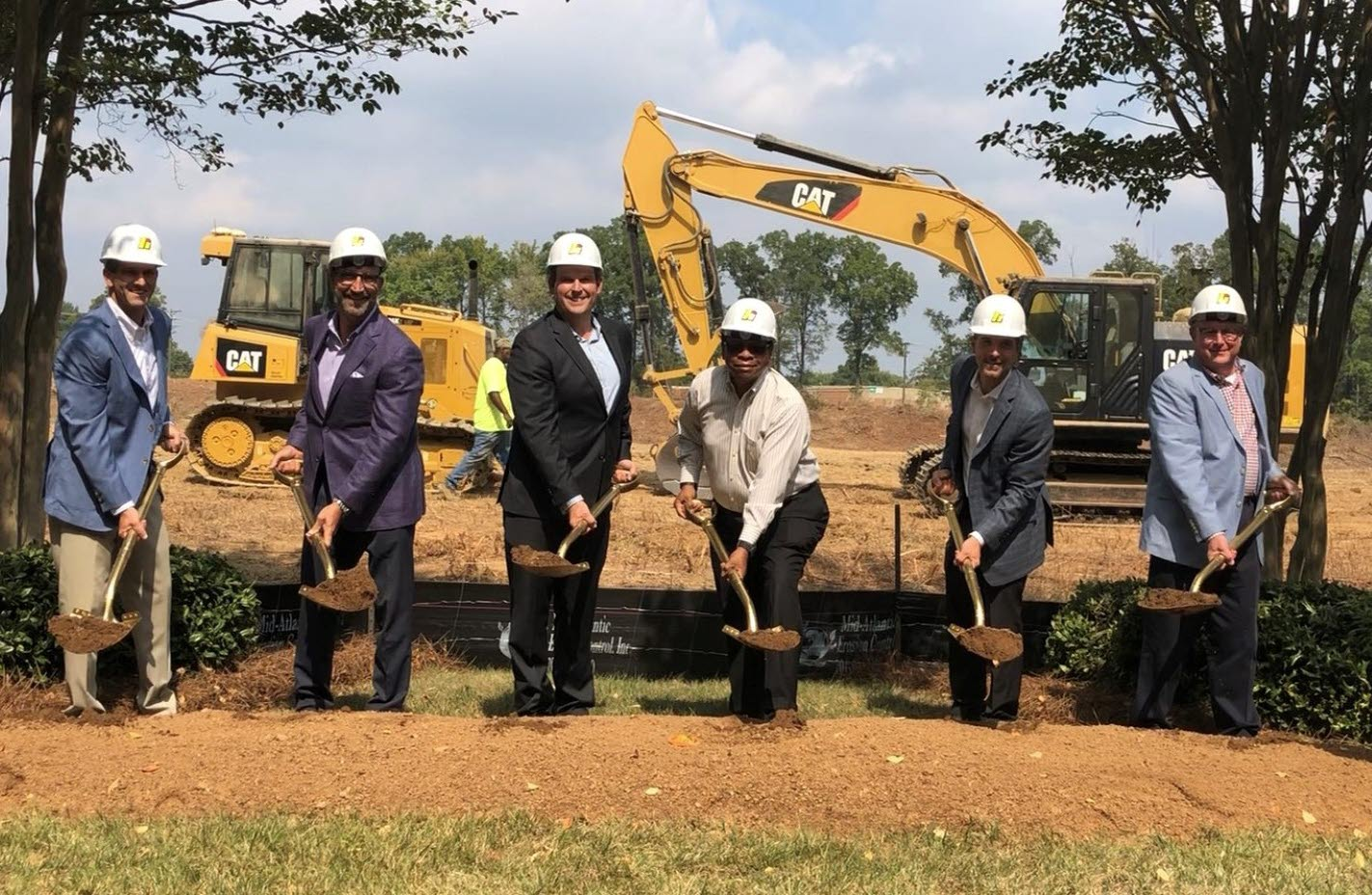 High companies and High Real Estate Group LLC executives join government and bank officials to break ground on Mallard Pointe Apartments, a new luxury-lifestyle community in Charlotte, N.C.