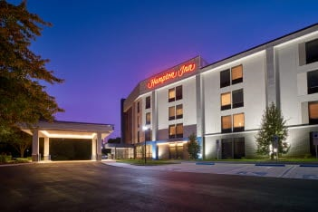 The exterior of the Hampton Inn-Harrisburg West at night.